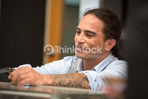 Small business owner, cafe owner serving customers : Stock Photo