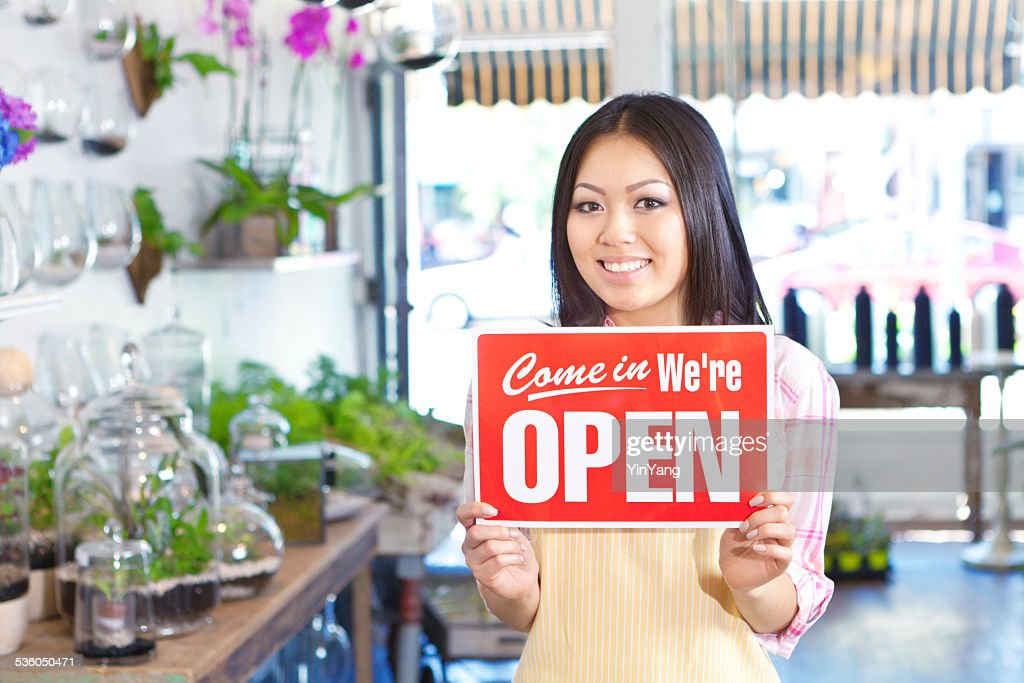 Small Business Owner Florist in Flower Shop Holding Open Sign