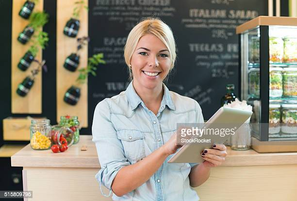 Small business owner holding a digital tablet.
