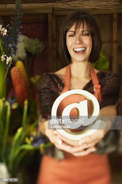 Small business owner holding at symbol
