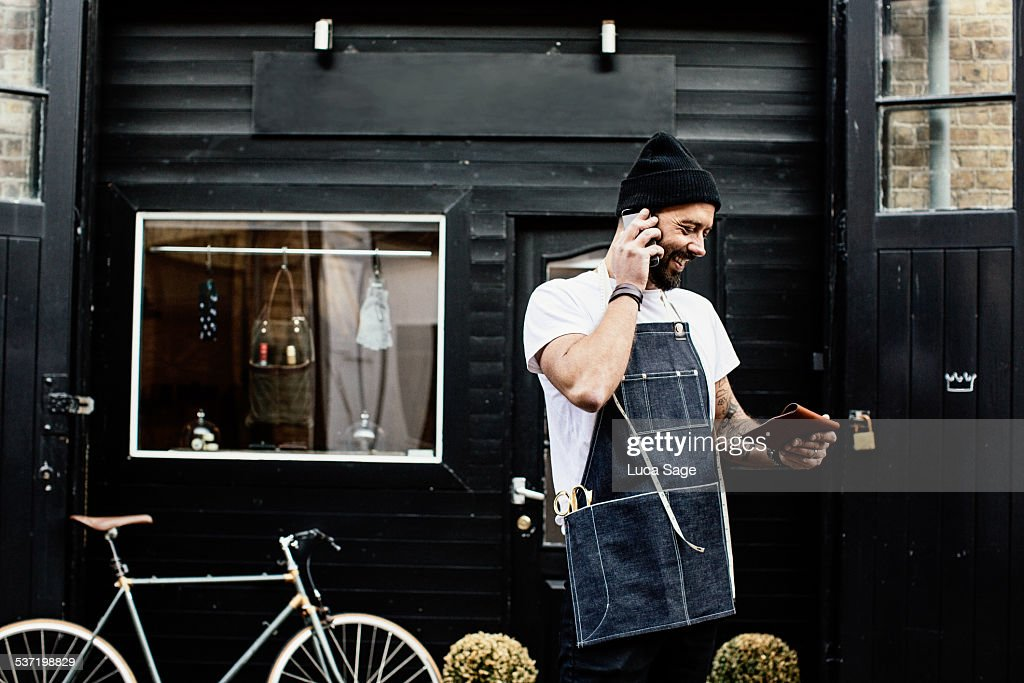 Small Business Owner outside his shop : Stock Photo