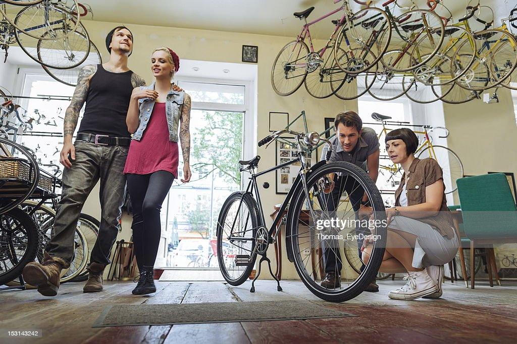 Small business Owner selling  Bicycles : Stock Photo