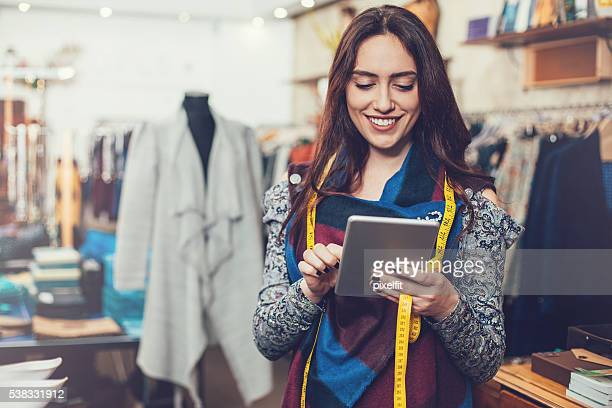 Small business owner with digital tablet