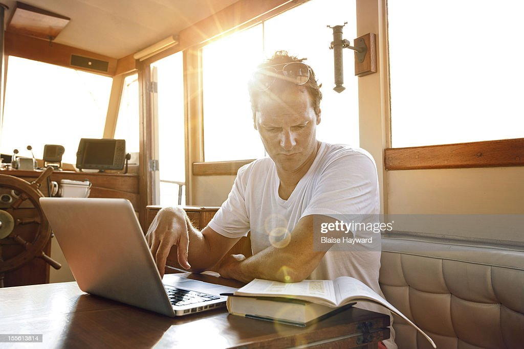 Small business owner working on a boat
