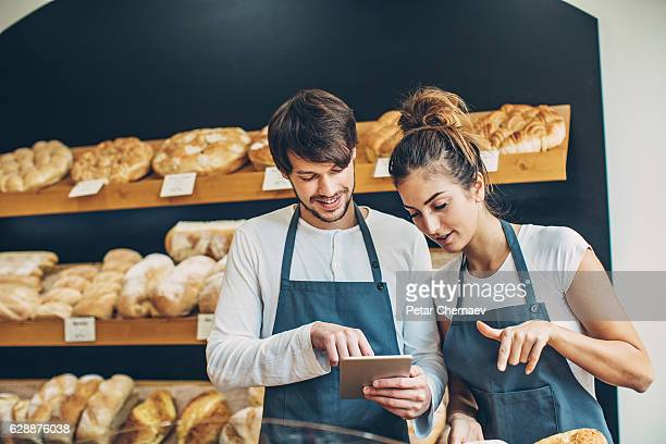 Small business owners checking a digital tablet