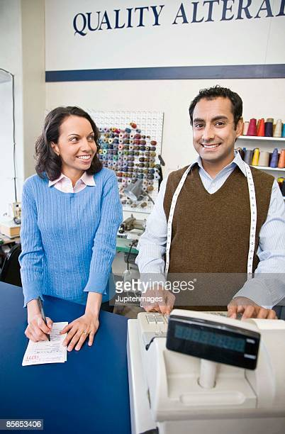 Small business owners in tailor shop