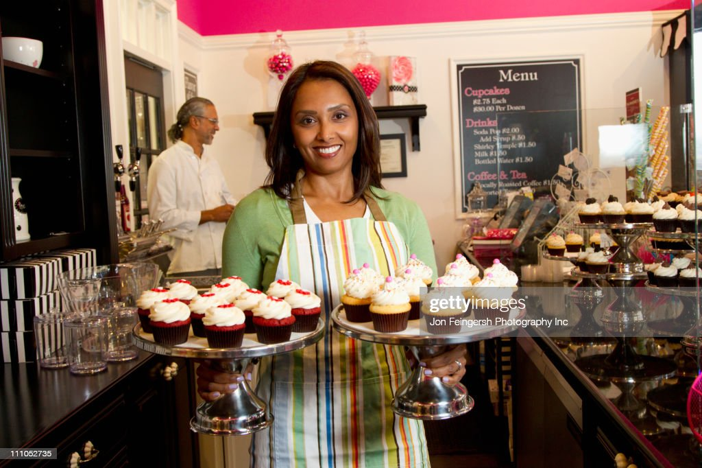 Small Business Owners With Cupcakes In Bakery Shop Stock Photo  Getty Images