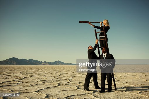 Small Business Team Search through Telescope on Salt Flats