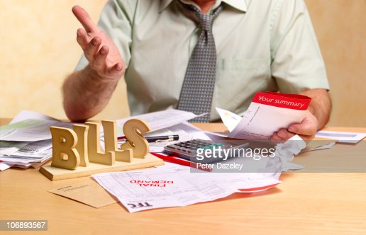 Small businessman dealing with tax return : Stock Photo