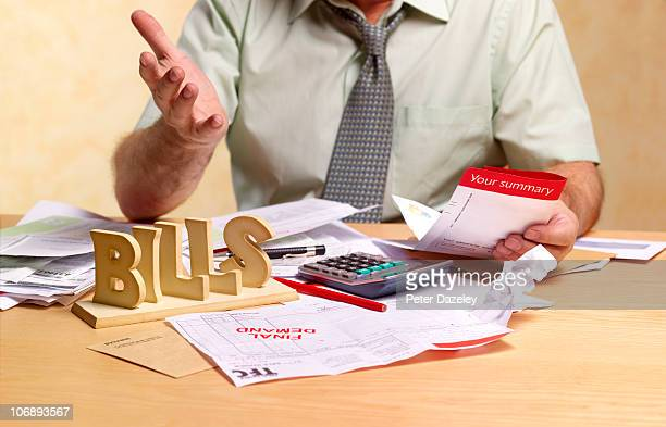 Small businessman dealing with tax return