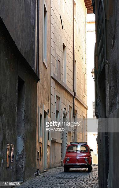 Small Car in a narrow alley, Rome Italy