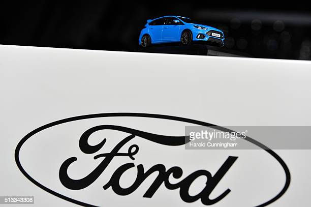 A small car stands above a Ford logo during the Geneva Motor Show 2016 on March 2 2016 in Geneva Switzerland