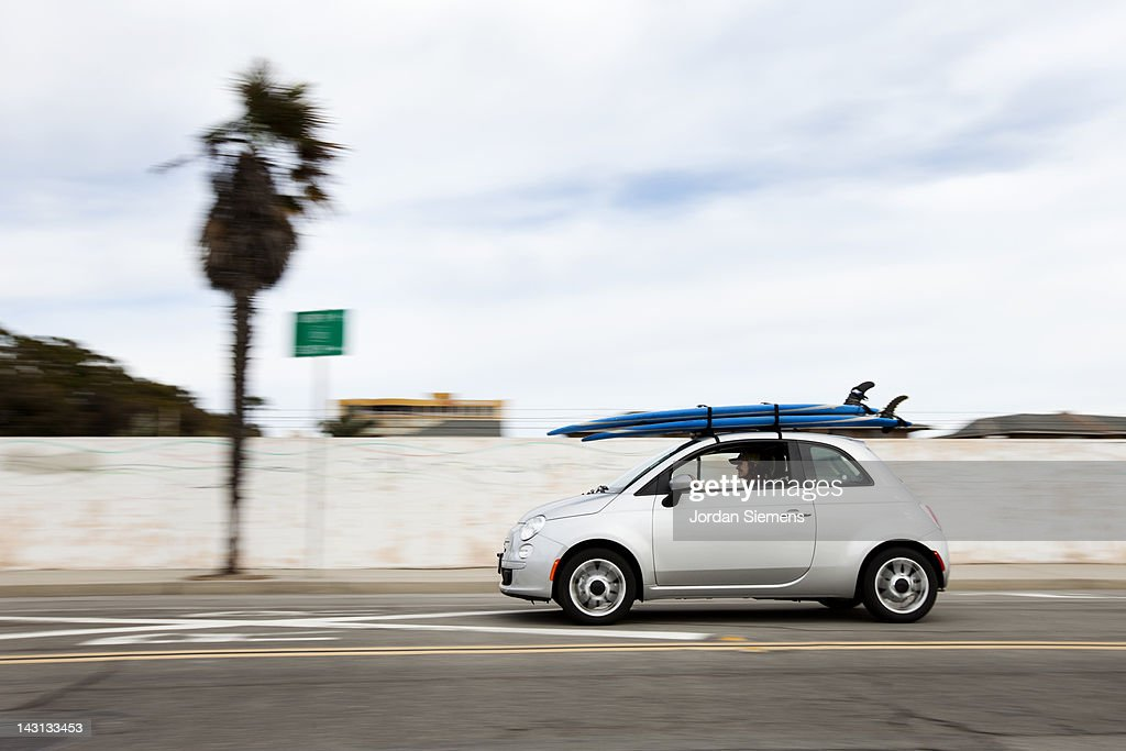 A small car with surfboards. : Stock Photo