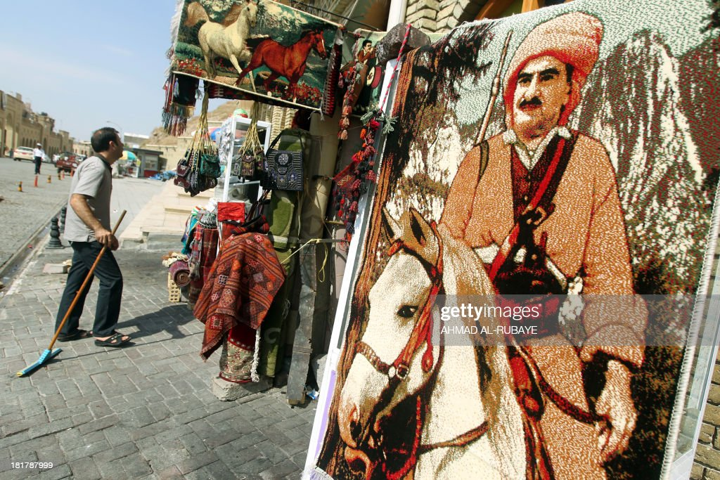 A small carpet depicting Mustafa Barzani, the father of Massud Barzan,i the president of Kurdistan region, hangs outside a carpet shop in the northern regional capital of Arbil on September 22, 2013 in Iraq. Voters in Iraq's Kurdish region may have had differing views at the ballot box during weekend polls, but there is one dream which unites virtually all of them: an independent state. AFP PHOTO