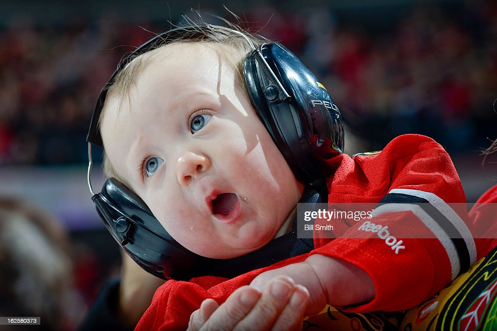 A small Chicago Blackhawks fan during the National Anthem before the NHL game against the Columbus Blue Jackets on February 24, 2013 at the United Center in Chicago, Illinois.