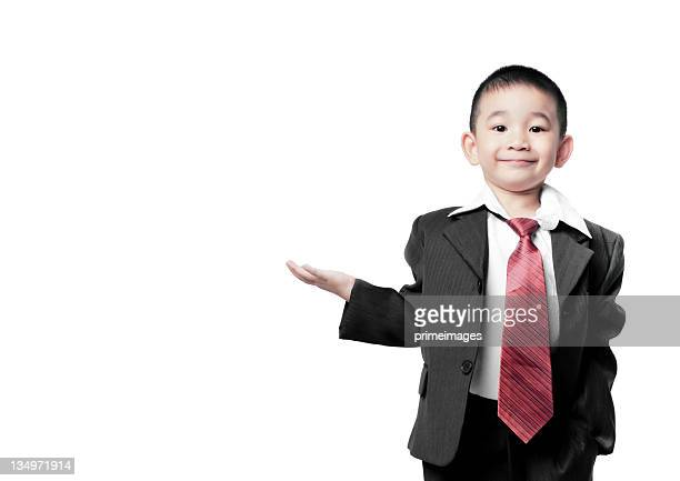 Small child dressed as businessman with hand held palm up