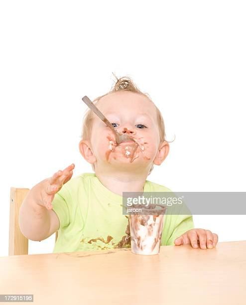 small child eating yoghurt