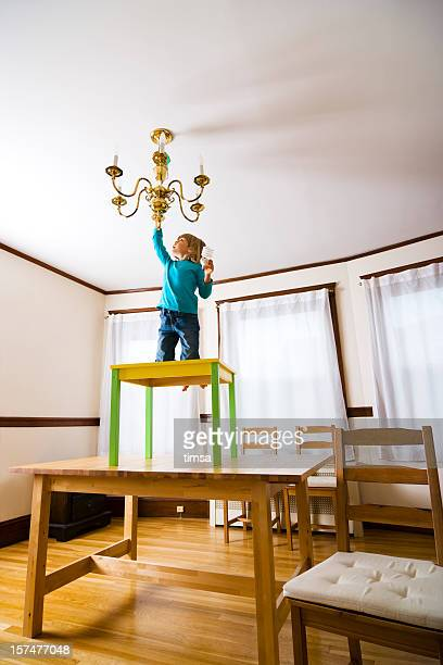 Small child exchanging lightbulb