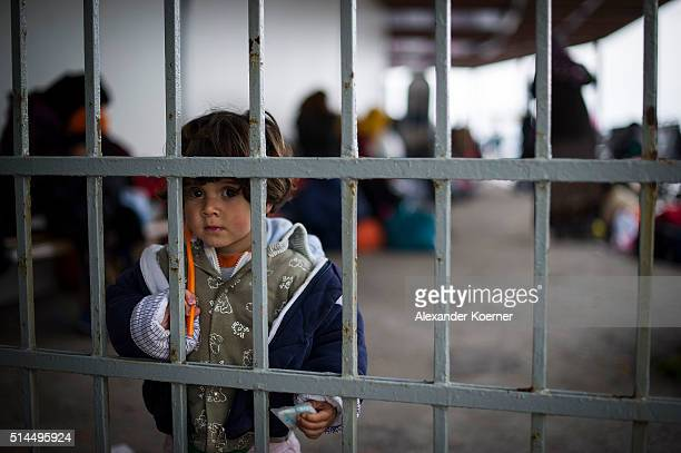A small child from Afghanistan is seen inside the Port of Mytelene prior boarding a ferry which will bring 500 refugees to Athens on March 9 2016 in...