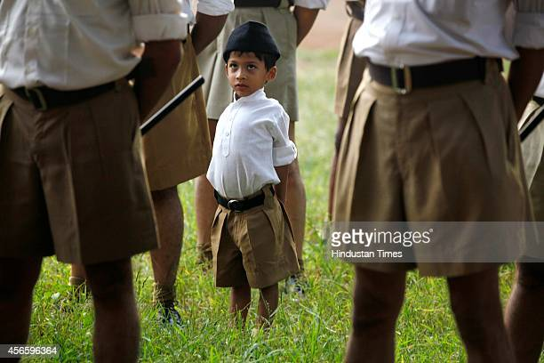 A small child stands amidst RSS activists assembled on the occasion of Vijayadashami at Malad on October 3 2014 in Mumbai India RSS was formed on...