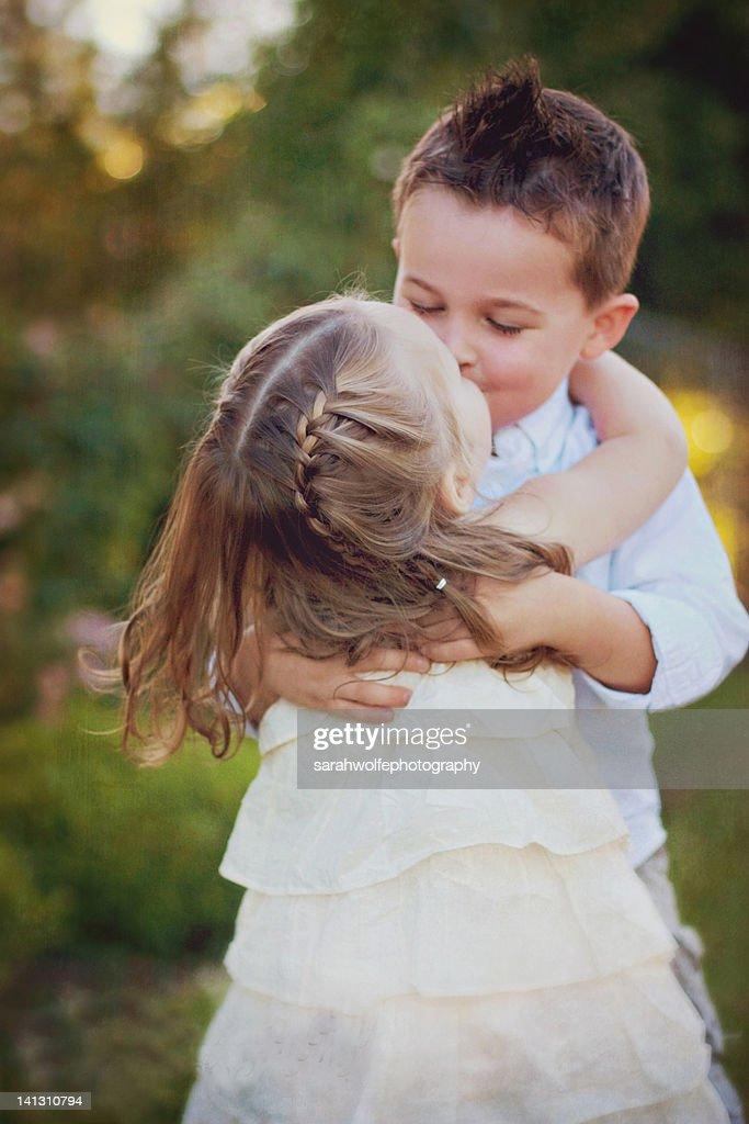 small children kissing stock photo