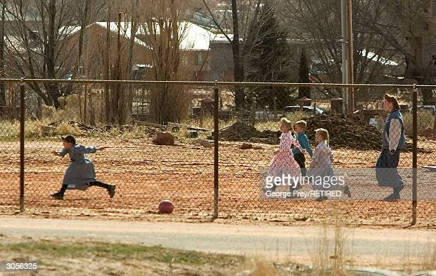 Small children play ball in the dirt yard of one of the many schools in Colorado City Arizona that is owned and run by the Fundamentalist Church of...