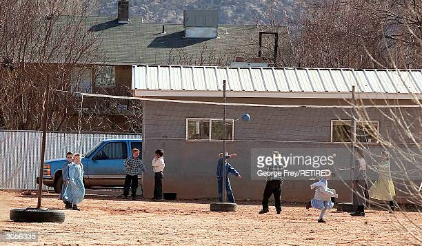 Small children play in the dirt yard of one of the many schools in Colorado City Arizona that is owned and run by the Fundamentalist Church of Jesus...