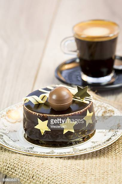 Small chocolate cake and cup of espresso