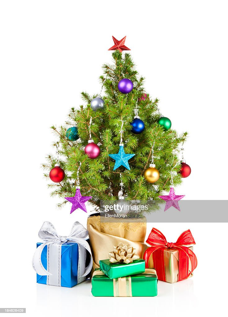 small christmas tree with gifts under it stock photo - Small Christmas Tree