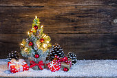 Little Christmas tree with gift boxes