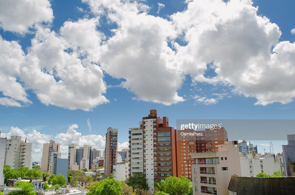Small city with clouds : Stock Photo