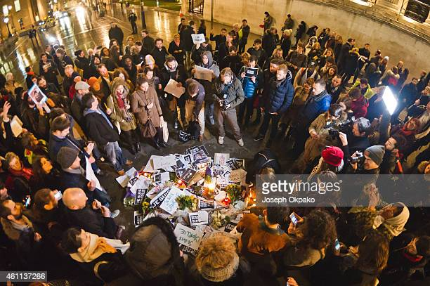 A small crowd gathers in solidarity during a vigil in Trafalgar Square for victims of the terrorist attack in Paris on January 7 2015 in London...