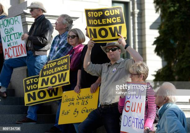 A small crowd gathers on the west steps of the state capitol to join the Colorado Coalition Against Gun Violence for a rally on October 8 2017 in...