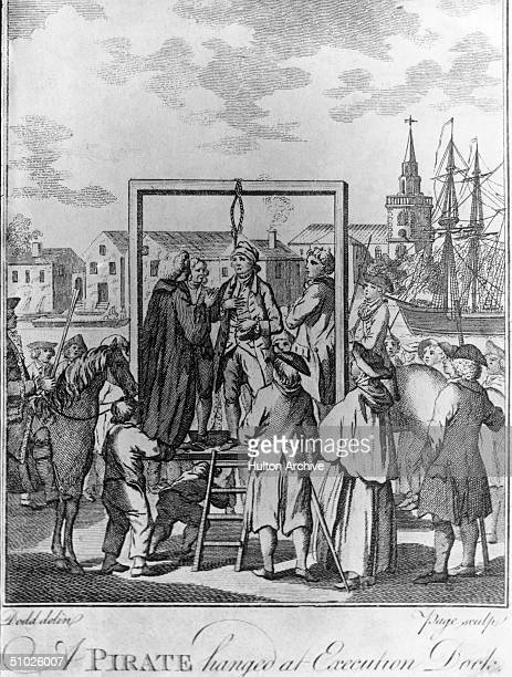 A small crowd gathers to watch a pirate being hanged at Execution Dock in London circa 1700 Engraving by Page