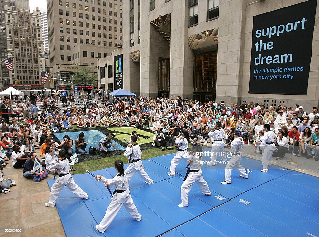 A small crowd of people watch a karate demonstration during the live viewing party of New York City's final Olympic bid presentation July 5 2005 at...
