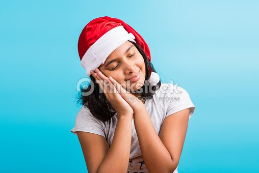 ef5e1b5b221 ... small cute indian girl with christmas hat sleeping stock photo