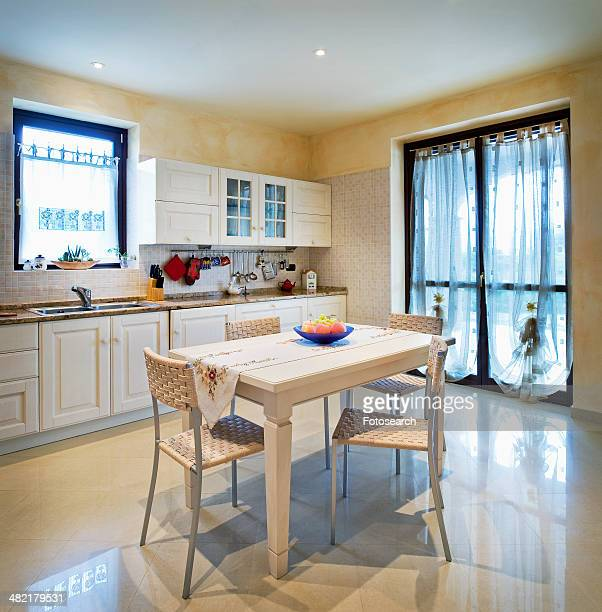 Small dining table in traditional kitchen