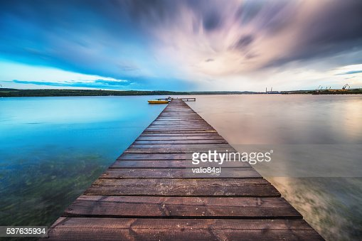 Small Dock and Boat at the lake : Stock Photo