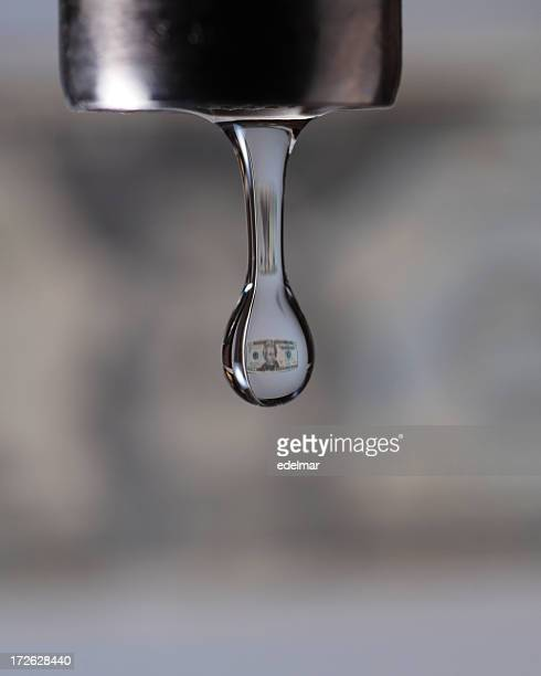 Small dollar image inside a close up photo of a faucet drip