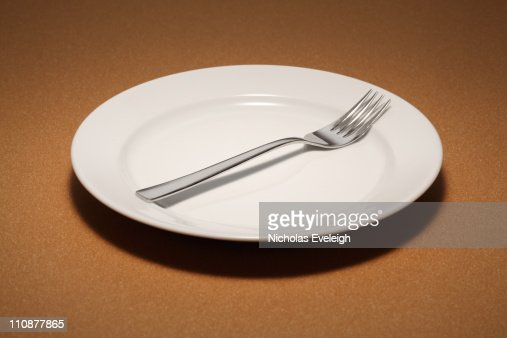 Small empty plate with fork : Stock Photo