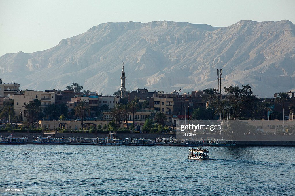 A small ferry boat prepares to dock on the East Bank of the River Nile on October 23 2013 in Luxor Egypt Luxor one of Egypt's major tourist hotspots...