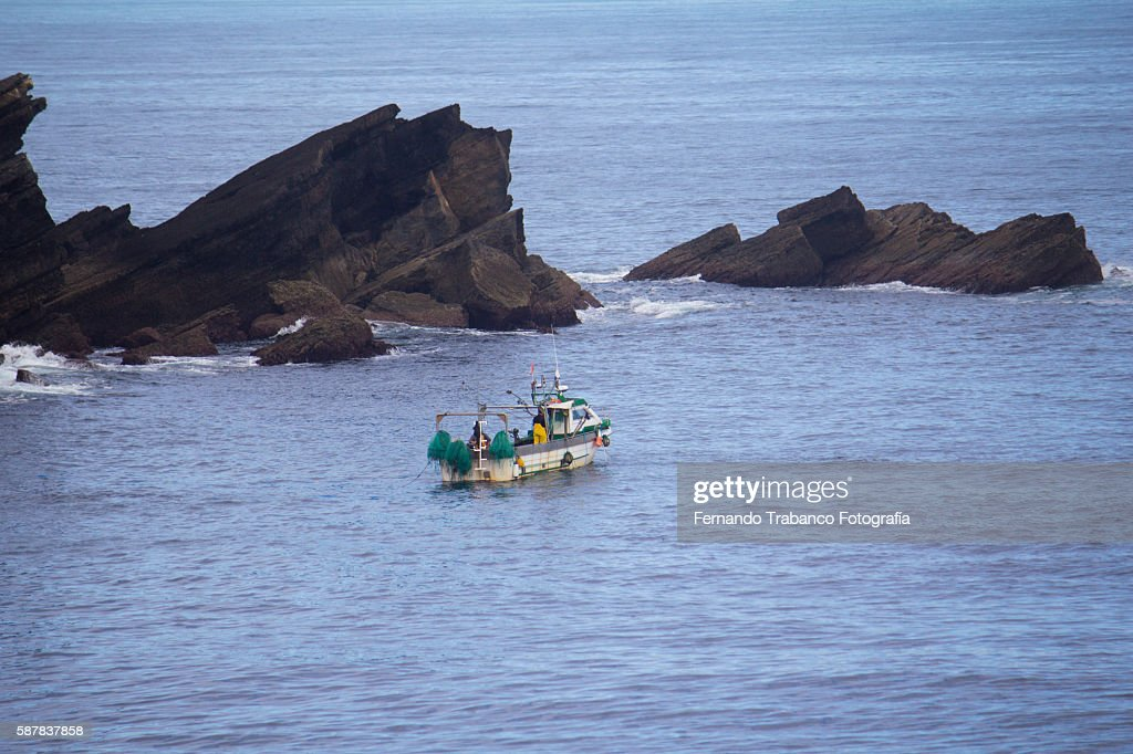 small fishing boat in the Mar Cantábrico , Asturias (Spain)