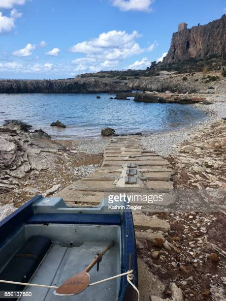 Small fishing boat on a rocky beach near San Vito lo Capo, Sicily