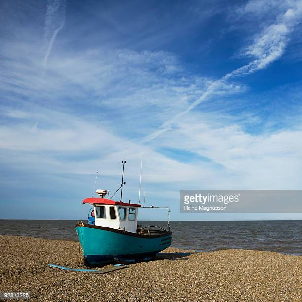 Small fishing boat on shore, UK