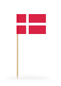 Small Denmark flag on a toothpick. The flag has nicely detailed paper texture. High quality 3d render. Isolated on white background.