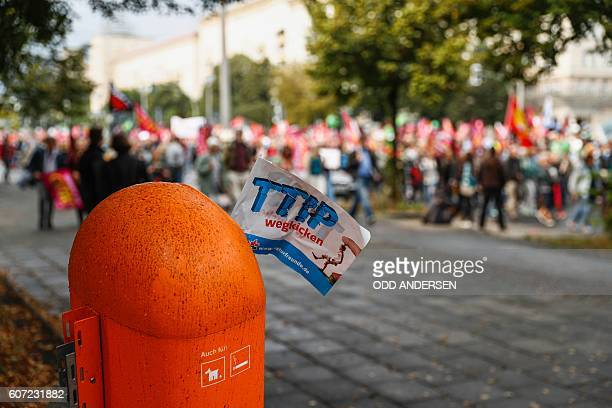 A small flag reading 'Kick away TTIP' sticks in a dustbin during a demonstration against the massive transatlantic trade deals CETA and TTIP on...