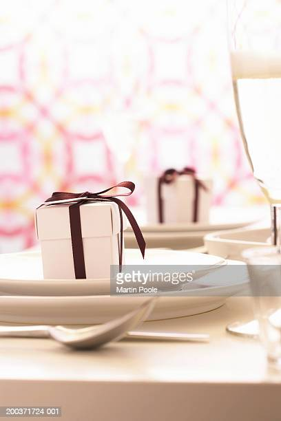 Small gift box on plate, close up