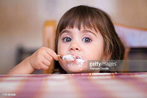 Small girl eating an ice cream