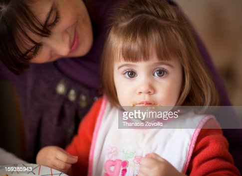 Small girl eating : Stock Photo