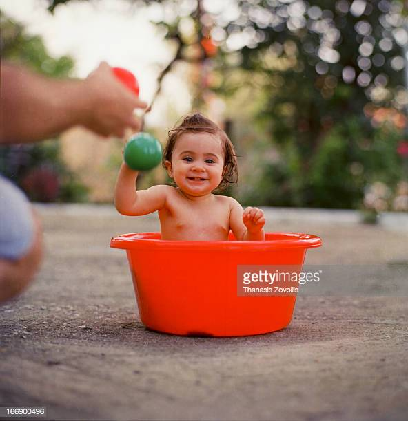 Small girl in a washing tub